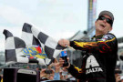 Jeff Gordon, driver of the #24 Axalta Chevrolet, celebrates in Victory Lane after winning the NASCAR Sprint Cup Series Crown Royal Presents The John Wayne Walding 400 at the Brickyard Indianapolis Motor Speedway on July 27, 2014 in Indianapolis, Indiana. - Photo Credit: Rainier Ehrhardt/Getty Images