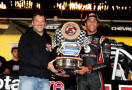 Eldora Speedway Track Owner Tony Stewart presents Darrell Wallace Jr. , driver of the #54 ToyotaCare Toyota, with a trophy after winning the Camping World Truck 2nd Annual 1-800 Car Cash Mudsummer Classic at Eldora Speedway on July 23, 2014 in Rossburg, Ohio. - Photo Credit: Sean Gardner/Getty Images