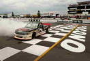 Austin Dillon, driver of the #3 Yuengling Light Lager Chevrolet, celebrates with a burnout after winning the NASCAR Camping World Truck Series Pocono Mountains 150 at Pocono Raceway on August 2, 2014 in Long Pond, Pennsylvania. - Photo Credit: Elsa/Getty Images