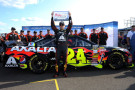 Jeff Gordon, driver of the #24 Axalta Chevrolet, celebrates with the Coors Light Pole Award after qualifying for the NASCAR Sprint Cup Series Pure Michigan 400 at Michigan International Speedway on August 15, 2014 in Brooklyn, Michigan. - Photo Credit: Robert Reiners/Getty Images