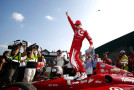 Scott Dixon of New Zealand, driver of the #9 Target Chip Ganassi Racing Dallara Chevrolet, celebrates after winning the Verizon IndyCar Series Honda Indy 200 at Mid-Ohio Sports Car Course on August 3, 2014 in Lexington, Ohio. - Photo Credit: Kirk Irwin/Getty Images