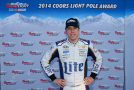 Brad Keselowski, driver of the #2 Miller Lite Ford, celebrate setting the pole position during qualifying for the NASCAR Sprint Cup Series Sylvania 300 at New Hampshire Motor Speedway on September 19, 2014 in Loudon, New Hampshire. - Photo Credit: Chris Trotman/Getty Images