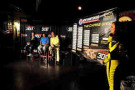 With the help of Miss Sprint Cup, (l-r) Kasey Kahne, Joe Lunardi and Dick Vitale play the Chase Grid game at the Hard Rock Café in Boston on Wednesday.