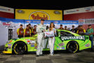 Kyle Busch, driver of the #18 Doublemint Toyota, left, and Ms. Coors Lite Rachel Rupert, right, pose with the Coors Lite Pole Award after Busch qualified for the pole for the NASCAR Sprint Cup Series Bank of America 500 at Charlotte Motor Speedway on October 9, 2014 in Charlotte, North Carolina. - Photo Credit: Streeter Lecka/Getty Images