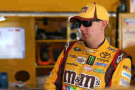 Kyle Busch, driver of the #18 M&M's Halloween Toyota, stands in the garage area - Photo Credit: Todd Warshaw/Getty Images