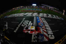 Kevin Harvick, driver of the #4 Budweiser Chevrolet, takes the checkered flag to win the NASCAR Sprint Cup Series Bank of America 500 at Charlotte Motor Speedway on October 11, 2014 in Charlotte, North Carolina. - Photo Credit: Chris Trotman/Getty Images