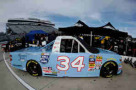 A view of the #34 2015 NASCAR Hall of Fame Inductee Wendell Scott Toyota, driven by Darrell Wallace, Jr., in the garage area during practice for the NASCAR Camping World Truck Series Kroger 200 at Martinsville Speedway on October 24, 2014 in Martinsville, Virginia. - Photo Credit: Rainier Ehrhardt/NASCAR via Getty Images