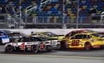 Kevin Harvick, No. 4 Jimmy Johns Chevrolet battles rival Joey Logano in the No. 22 Shell-Pennzoil Ford during Saturday night's Sprint Unlimited at Daytona International Speedway. (Photo Credit: Nigel Kindrade / NKP)