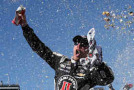 Kevin Harvick, driver of the #4 Jimmy John's/ Budweiser Chevrolet, celebrates in victory lane after winning the NASCAR Sprint Cup Series CampingWorld.com 500 at Phoenix International Raceway on March 15, 2015 in Avondale, Arizona. - Photo Credit: Chris Graythen/Getty Images