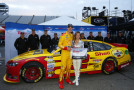 Joey Logano (left), driver of the #22 Shell Pennzoil Ford, poses with Miss Coors Light Rachel Rupert after winning the Coors Light Pole Award for the NASCAR Sprint Cup Series STP 500 at Martinsville Speedway on March 27, 2015 in Martinsville, Virginia. - Photo Credit: Matt Sullivan/Getty Images