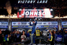 Jimmie Johnson, driver of the #48 Lowe's Pro Services Chevrolet, celebrates in Victory Lane after winning the NASCAR Sprint Cup Series Duck Commander 500 at Texas Motor Speedway on April 11, 2015 in Fort Worth, Texas. - Photo Credit: Sarah Glenn/Getty Images