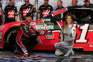 Kurt Busch, driver of the #41 Haas Automation Chevrolet, poses with Miss Coors Light Rachel Rupert after winning the Coors Light Pole Award during qualifying for the NASCAR Sprint Cup Series Duck Commander 500 at Texas Motor Speedway on April 10, 2015 in Fort Worth, Texas. - Photo Credit: Sarah Glenn/Getty Images