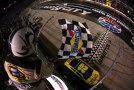 Matt Kenseth, driver of the #20 Dollar General Toyota, takes the checkered flag to win the NASCAR Sprint Cup Series Food City 500 at Bristol Motor Speedway on April 19, 2015 in Bristol, Tennessee. - Photo Credit: Sarah Glenn/Getty Images