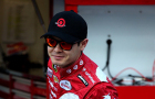 Kyle Larson, driver of the #42 Target Chevrolet, stands in the garage area during practice for the NASCAR Sprint Cup Series Food City 500 at Bristol Motor Speedway in Bristol, Tennessee. - Photo Credit: Sean Gardner/Getty Images