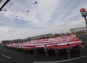 Troops from Fort Bragg unfurl a football field-sized American Flag during 2014 Coca-Cola 600 pre-race ceremonies. (CMS Photo/HHP)