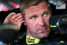 Clint Bowyer, driver of the #15 5-Hour Energy Toyota, sits in his car - Photo Credit: Jonathan Moore/Getty Images