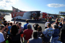Fans watch the NASCAR Sprint Cup Series Hauler Parade last July at New Hampshire Motor Speedway. This year's parade will run on Thursday, July 16 at 6 p.m. and will begin next to the NHMS Fan Zone. (NHMS)