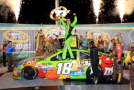 Kyle Busch, driver of the #18 M&M's Crispy Toyota, celebrates in Victory Lane after winning the NASCAR Sprint Cup Series Quaker State 400 presented by Advance Auto Parts at Kentucky Speedway on July 11, 2015 in Sparta, Kentucky. - Photo Credit: Daniel Shirey/Getty Images