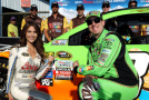 Kyle Busch, driver of the #18 M&M's Crispy Toyota, and Miss Coors Light Amanda Mertz pose with the Coors Light Pole Award after Busch qualifyied on the pole for the NASCAR Sprint Cup Series Windows 10 400 at Pocono Raceway on July 31, 2015 in Long Pond, Pennsylvania. - Photo Credit: Tim Bradbury/Getty Images