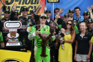 "Kyle Busch, driver of the #18 Interstate Batteries Toyota, and his wife Samantha pose in Victory Lane with ""Loudon the Lobster"" after winning the NASCAR Sprint Cup Series 5-Hour ENERGY 301 at New Hampshire Motor Speedway on July 19, 2015 in Loudon, New Hampshire. - Photo Credit: Rainer Ehrhardt/Getty Images"
