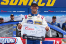 AJ Allmendinger, driver of the #47 Kroger/Bush's Beans Chevrolet, poses with the Coors Light Pole Award after qualifying for the pole position for the NASCAR Sprint Cup Series Cheez-It 355 at Watkins Glen International on August 8, 2015 in Watkins Glen, New York. - Photo Credit: Todd Warshaw/Getty Images
