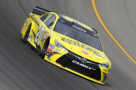 2015 NSCS Driver, Matt Kenseth, on track at Michigan International Speedway in the No. 20 Dollar General Toyota Camry - Photo Credit: Jerry Markland/Getty Images