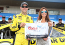 Matt Kenseth, driver of the #20 Dollar General Toyota, poses with Miss Coors Light Amanda Mertz after qualifying for the NASCAR Sprint Cup Series Pure Michigan 400 at Michigan International Speedway on August 14, 2015 in Brooklyn, Michigan. - Photo Credit: Nick Laham/Getty Images