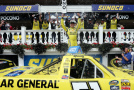 Kyle Busch, driver of the #51 Dollar General Toyota, celebrates in Victory Lane after winning the NASCAR Camping World Truck Series Pocono Mountains 150 at Pocono Raceway on August 1, 2015 in Long Pond, Pennsylvania. - Photo Credit: Nick Laham/Getty Images