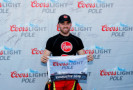 Austin Dillon, driver of the #33 Rheem Chevrolet, poses with the Coors Light Pole Award after qualifying for pole position NASCAR XFINITY Series Drive for the Cure 300 at Charlotte Motor Speedway on October 9, 2015 in Charlotte, North Carolina. - Photo Credit: Jonathan Ferrey/Getty Images
