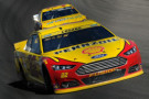 Joey Logano, driver of the #22 Shell Pennzoil Ford, leads during the NASCAR Sprint Cup Series Hollywood Casino 400 at Kansas Speedway on October 18, 2015 in Kansas City, Kansas. - Photo Credit: Ed Zurga/Getty Images